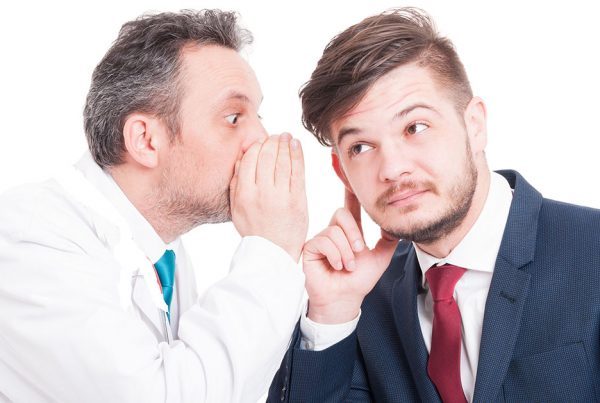 Dentist Whispering to Patient